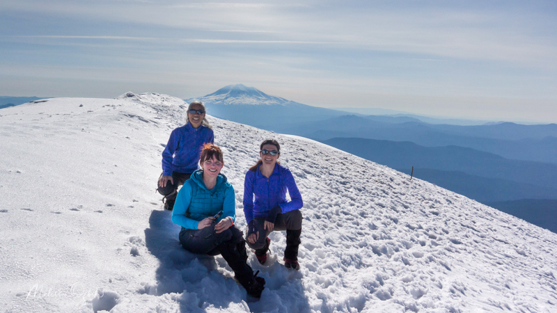 The crater rim of Mount St. Helens, with Grace and Margaret. Mount Adams in the background.