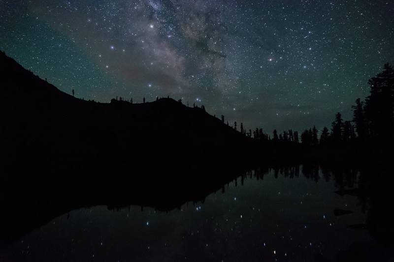 Stars and the Milky Way reflected in Summit Lake.