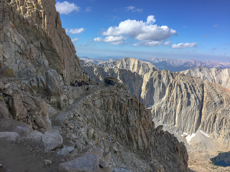 The junction of the John Muir Trail. Many JMT hikers drop their packs here before heading to the summit. The JMT approaches Mount Whitney from the west, the Mount Whitney Trail approaches from the east. They intersect here.