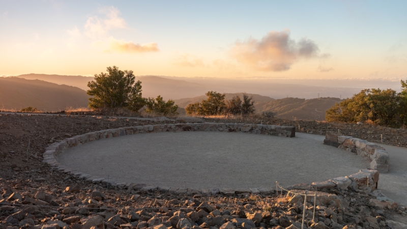 A ceremonial circle built to honor the Native American history on Mount Umunhum. The openings in the circle are to the east, symbolizing new beginnings and new opportunities just as the sun rises to the east at the start of a new day. The Amah Mutsun, a tribal band that is descended from the Ohlone people, use this circle for prayer and dance. They welcome everyone to use it to pray.