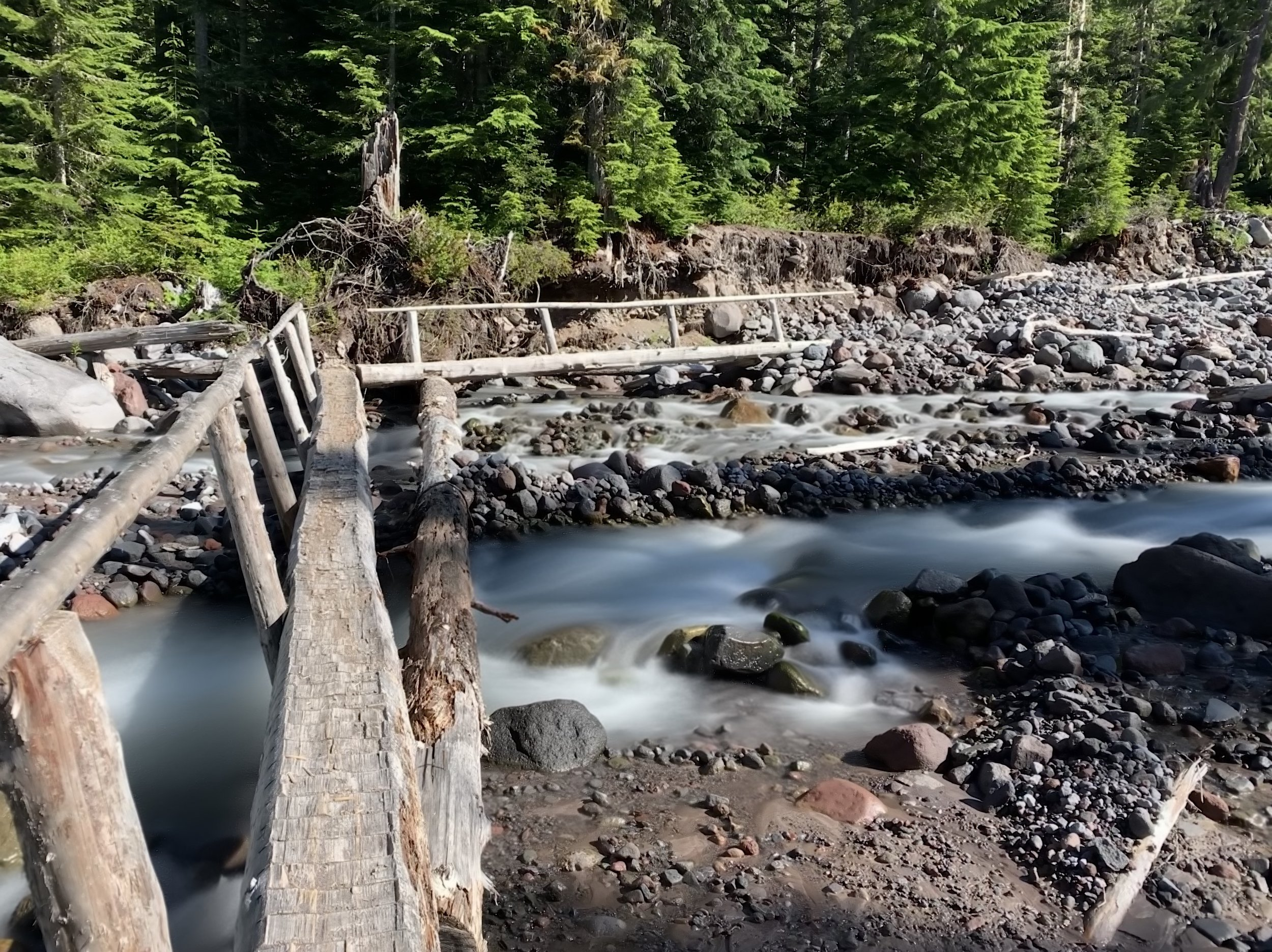 """Footbridge over Pyramid Creek. This is a """"live photo"""" converted to a long exposure."""