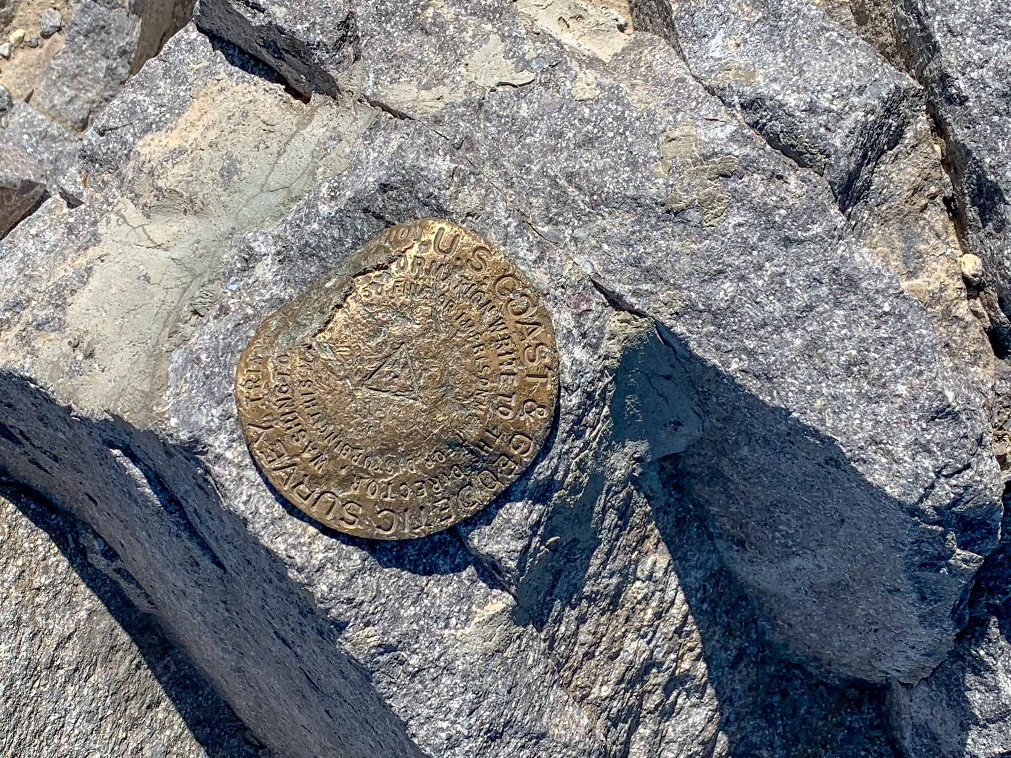 A survey marker at the summit