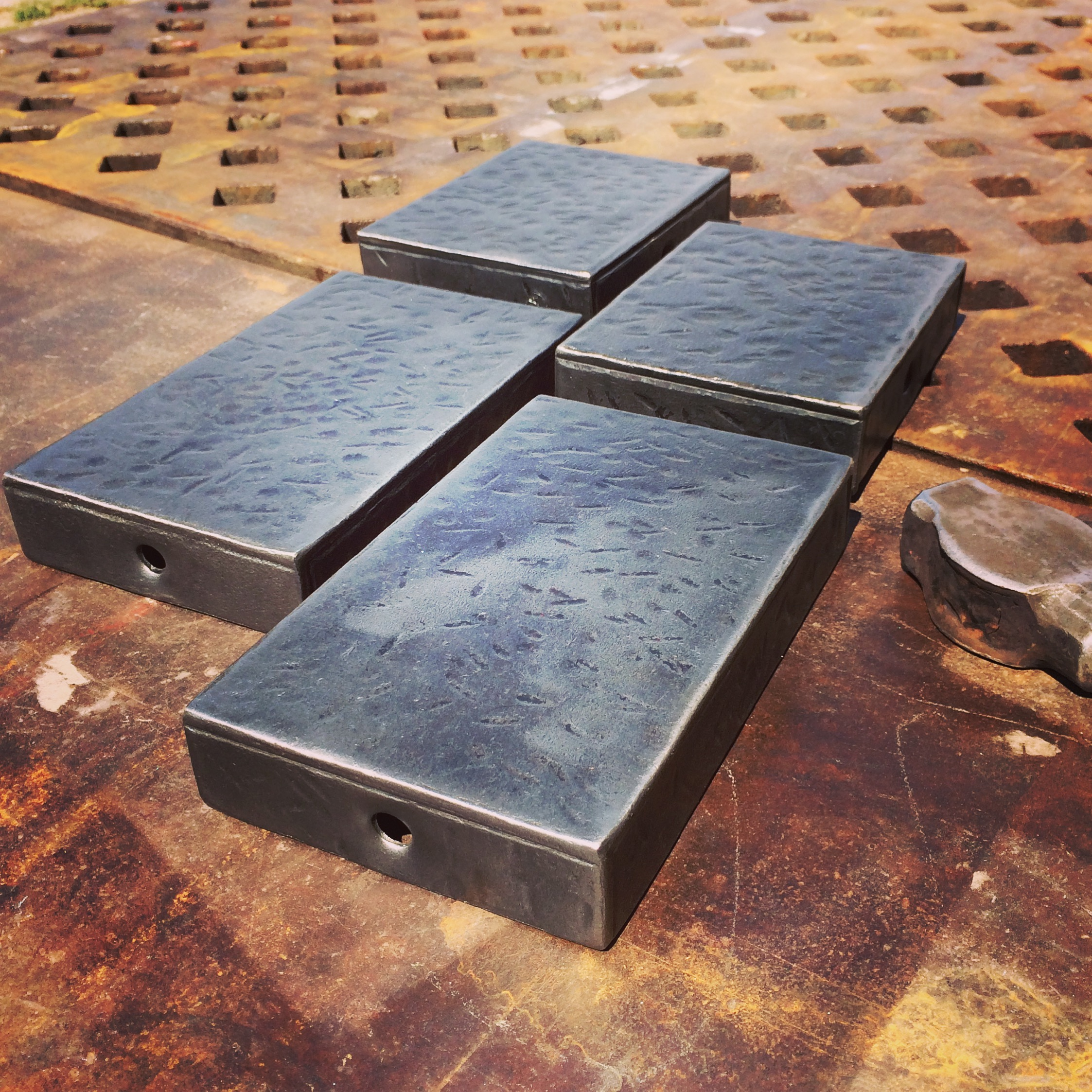 Hand forged beam caps for a timber frame home