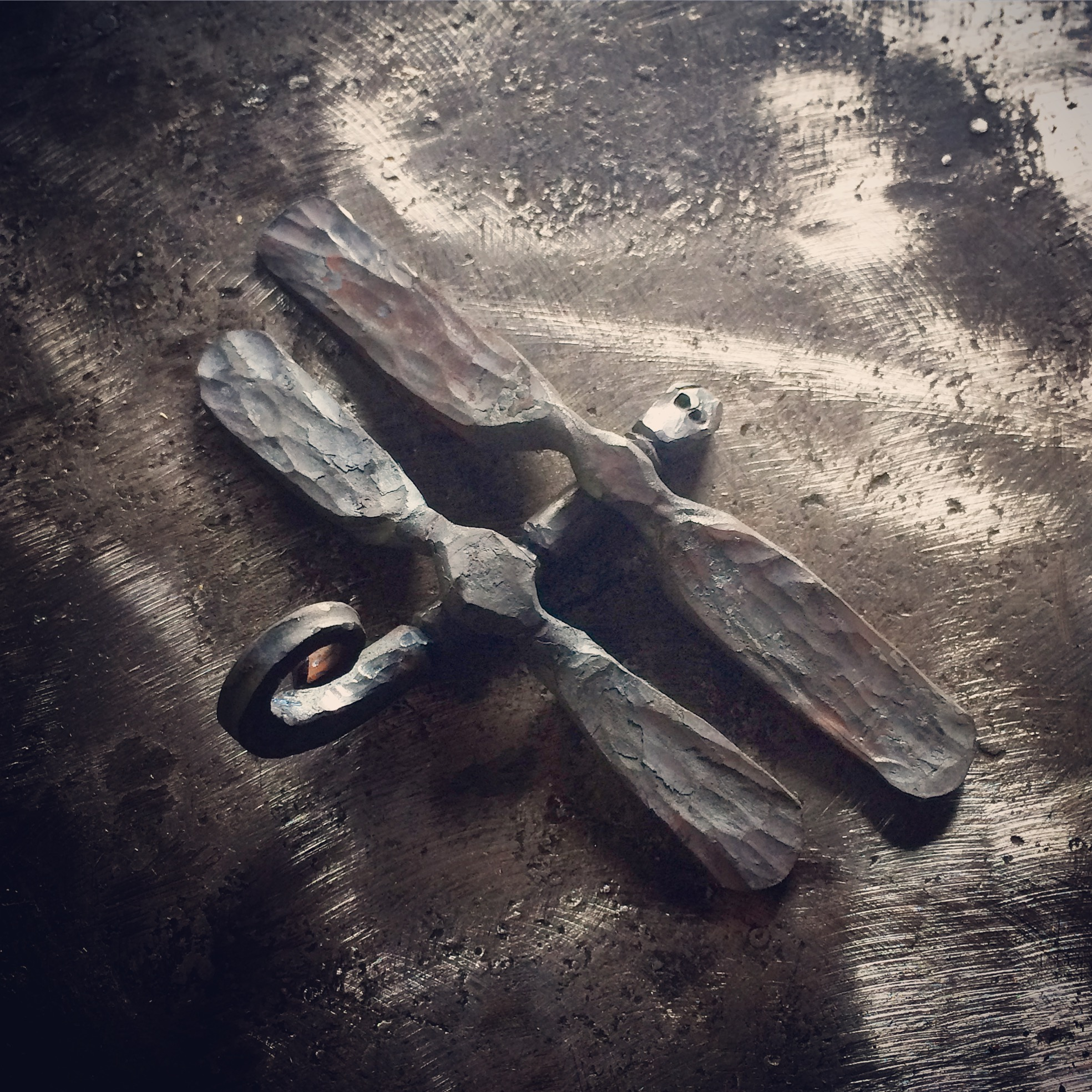 Hand forged firefly