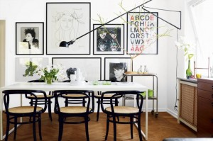 2 - wall of eclectic art in dining room