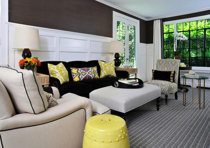 yellow ikat pillows - dark walls - wainscoting