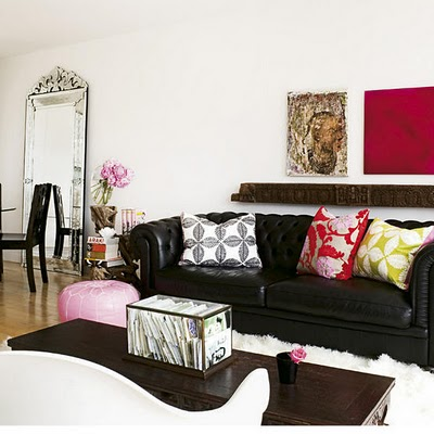 living rooms - black leather chesterfield sofa venetian floor mirror pink leather pouf wood coffee table black red lime green silk pillows  black