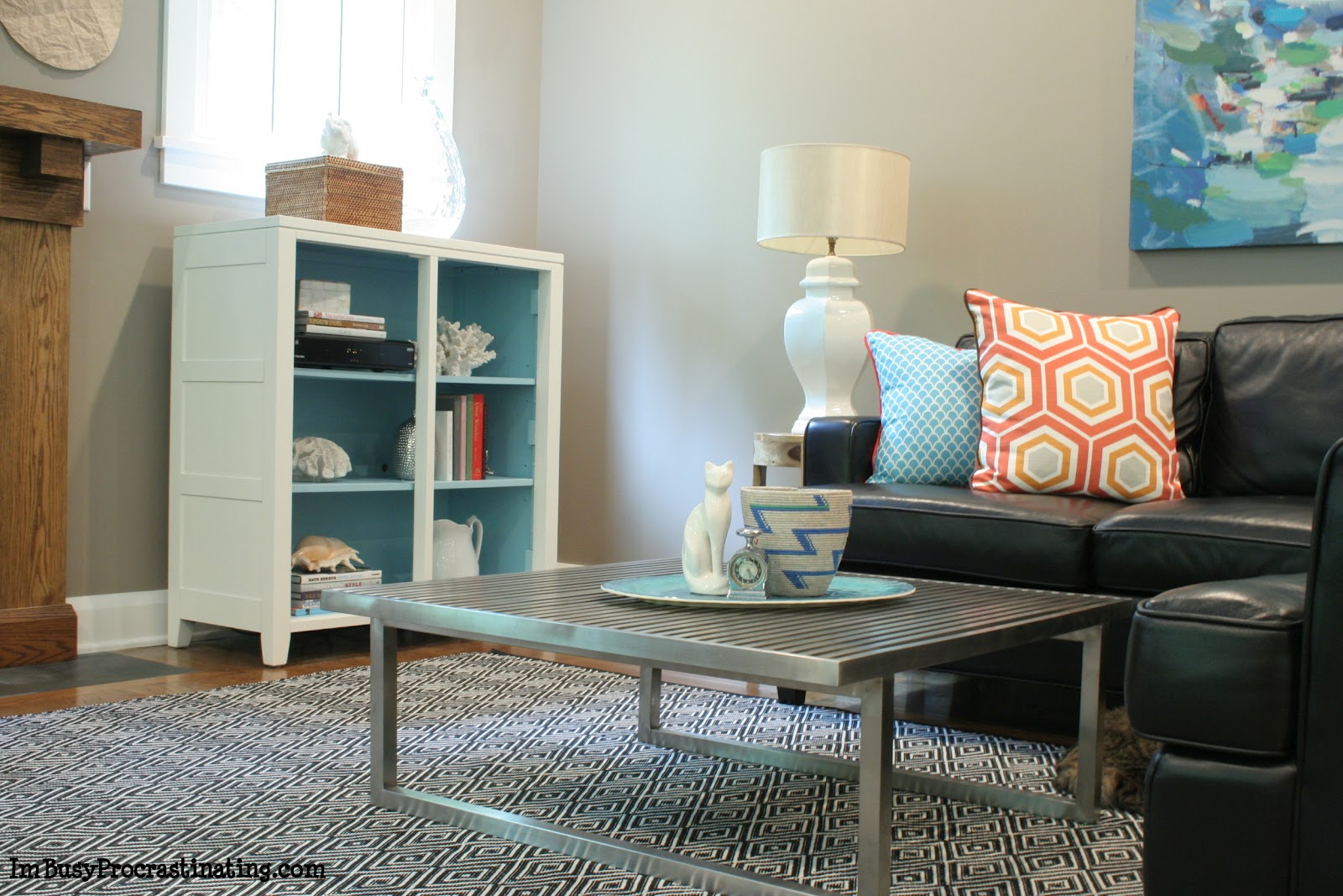 White & turquoise painted cabinet - living room view
