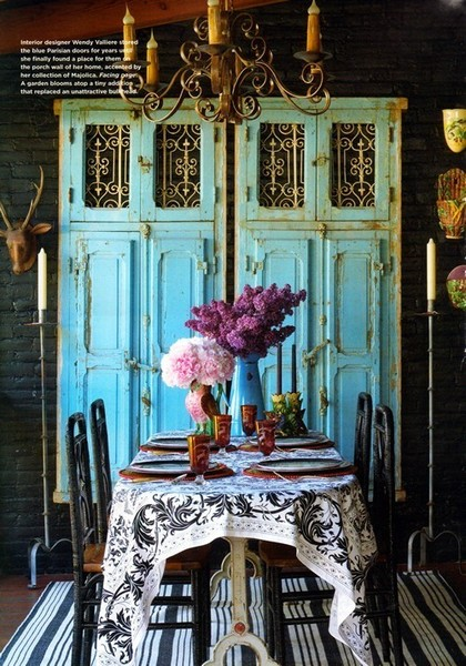 black and white dining room with turquoise armoire