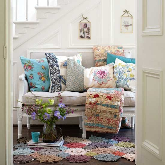 settee with pillows and colourful rug