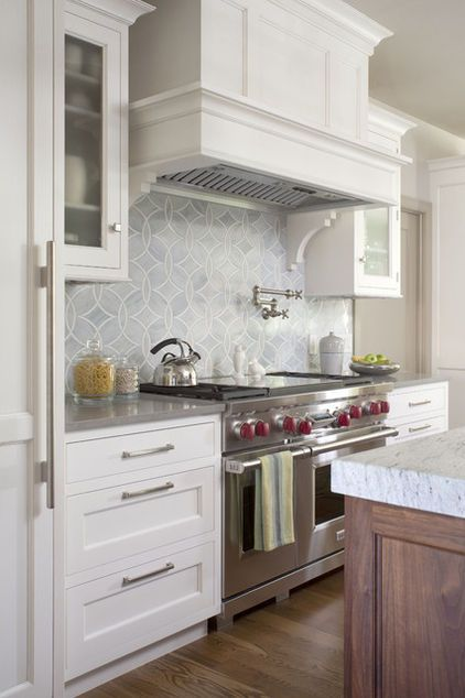 15 - wolf stove, shaker cabinets, wood island, marble backsplash