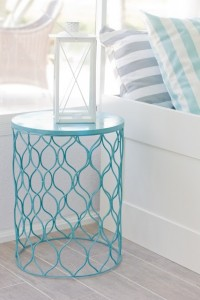 side table made of an upside down garbage bin - sprayed turquoise