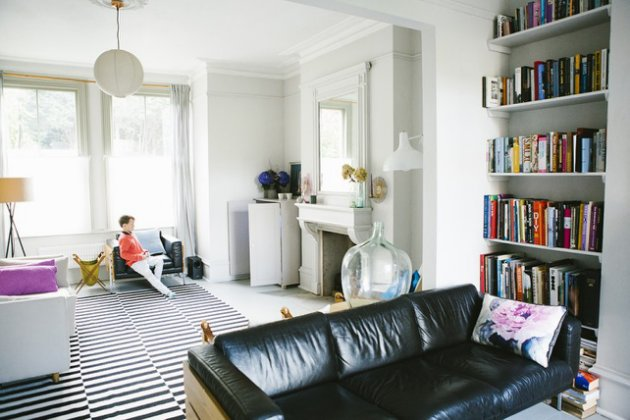 Love that this is a grand Victorian home with an Ikea rug and mismatched furniture