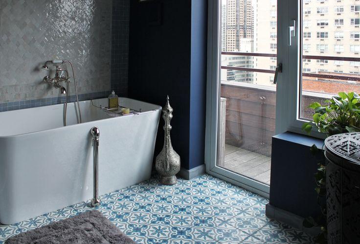 busy floor tile in bathroom with jewel toned walls.jpg