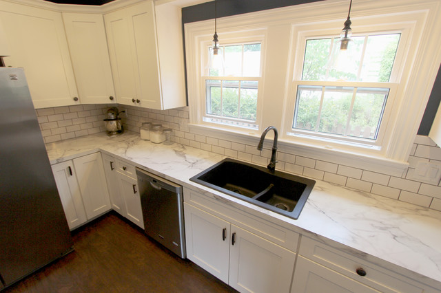 This is a faux marble laminate counter with a drop in sink!