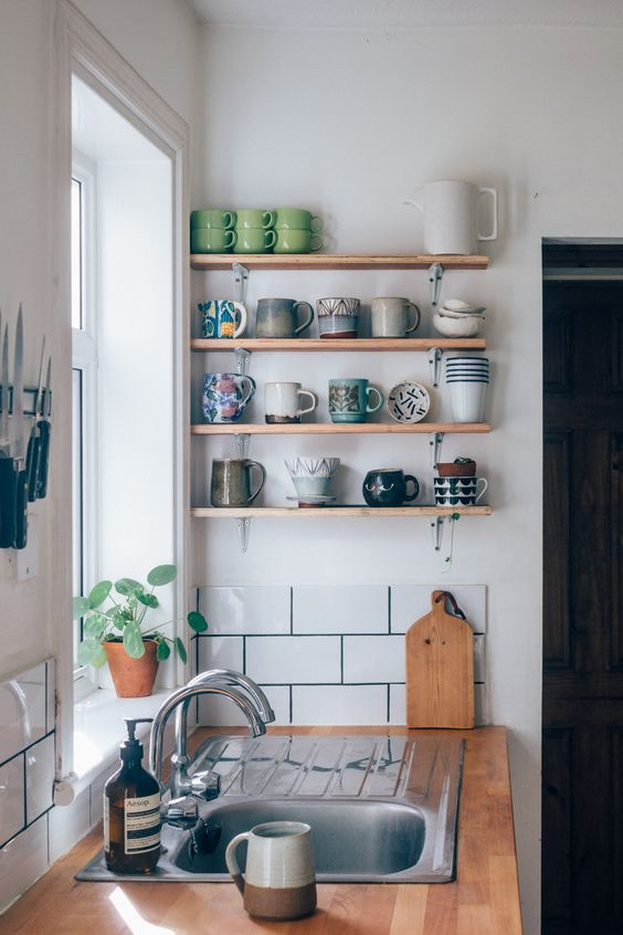 Use butcher block, subway tiles and open shelves for a lower cost trendy look.