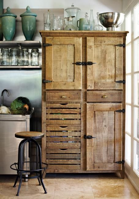 If you have a great piece of furniture you don't know what to do with, use it in your kitchen in place of new cabinets.