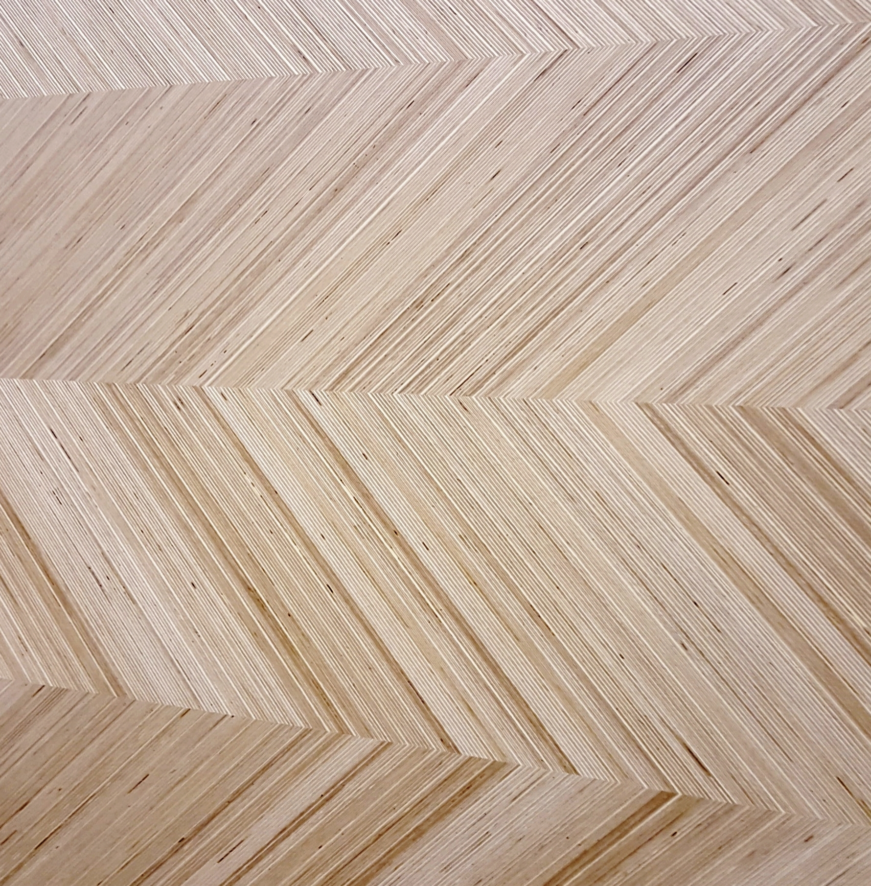 Think of the edge of a piece of plywood and you'll understand the beauty of this product. From Plexwood