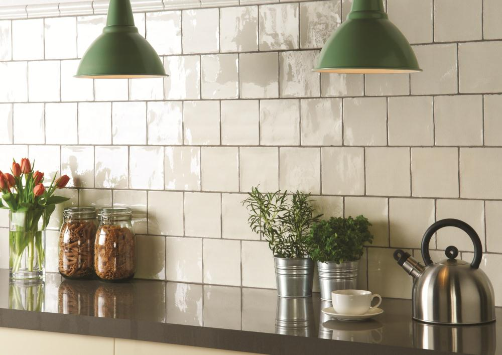 While I don't believe the subway tile is ever really gone, do now consider a square tile as the 'go-to' inexpensive option. This is a more expensive handmade version.