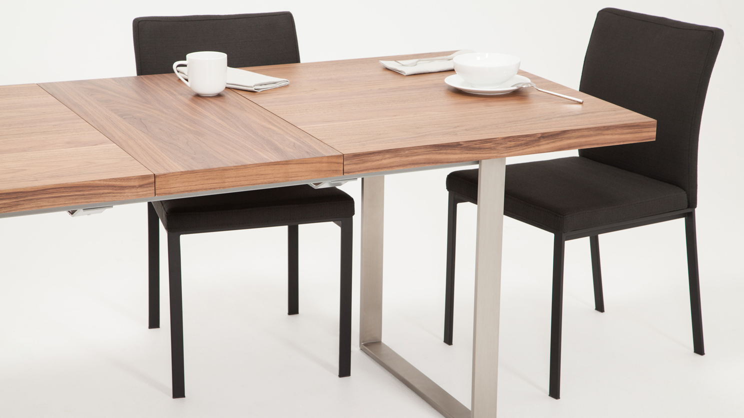 The Hatch dining table from EQ3 has a self storing leaf and a gorgeous walnut finish.