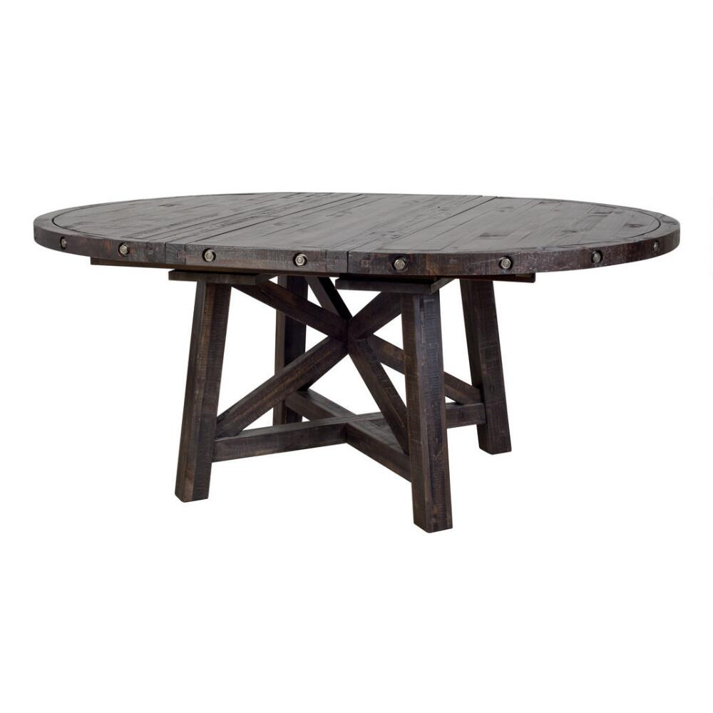 "Urban Barn has a few extension tables, but this round Ironside one caught my eye with its rugged finish and large size. It's 54"" round, with an 18"" leaf."