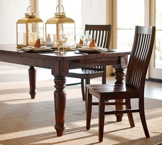 Pottery Barn's Sumner extension table has two leaves that attach to the ends so when not extended, there is no split down the middle. Consider pairing this solid table with some modern chairs for an eclectic look.
