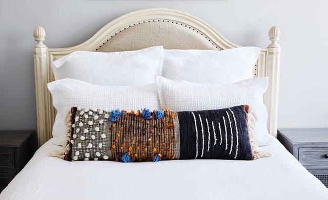 one long pillow on white linens.jpg
