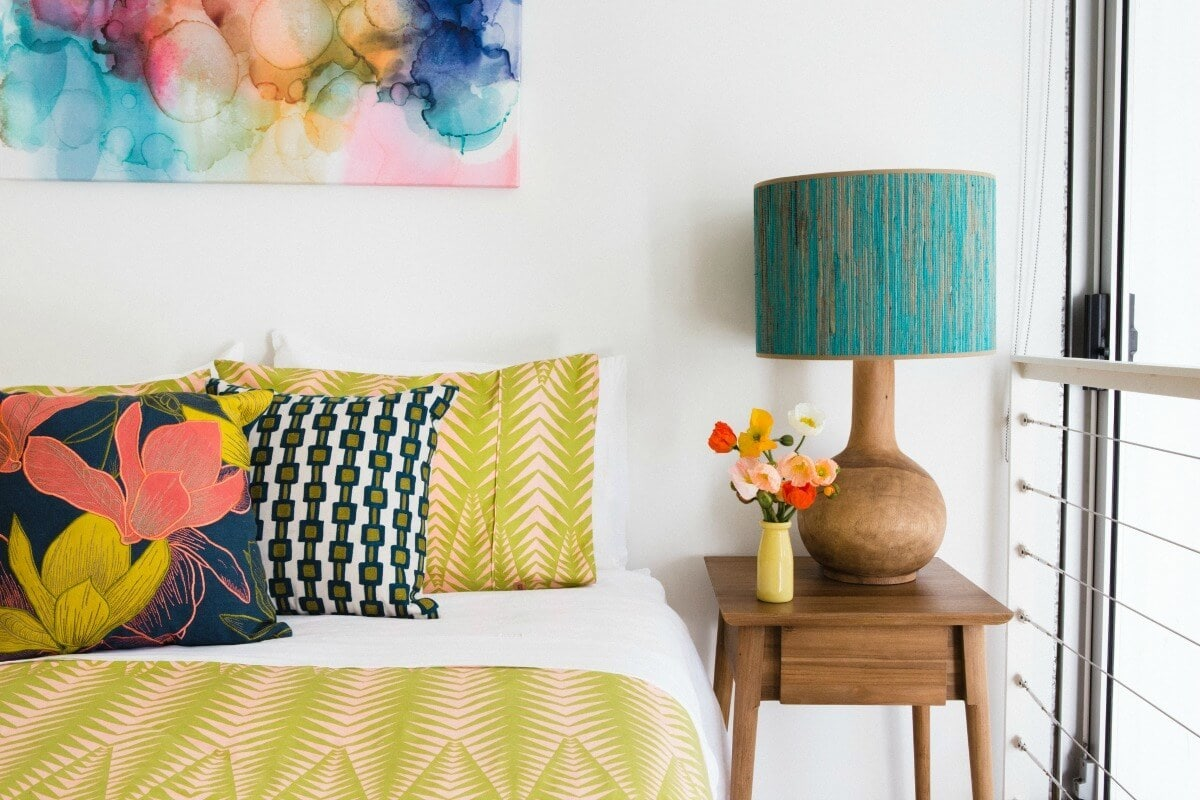 mustard-bedding-set-with-floral-bed-cushion-and-colourful-abstract-art-by-emma-blomfield.jpg