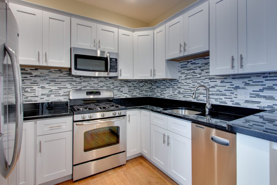 OUT - the narrow mosaic backsplash. It's just been around for too long and there are more exciting choices now.