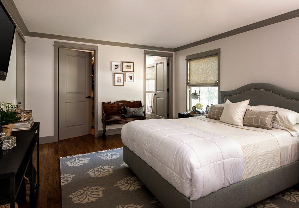 White-walls-dark-trim-bedroom-transitional-with-restored-trunk-white-bedding-wood-floors.jpg