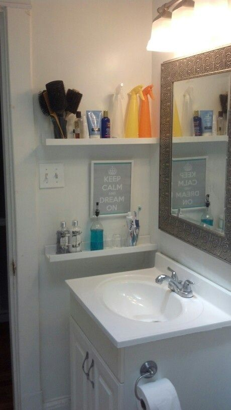 Inexpensive picture ledges are perfect for all the smaller items you store in your bathroom. Get creative and use them as display as well.