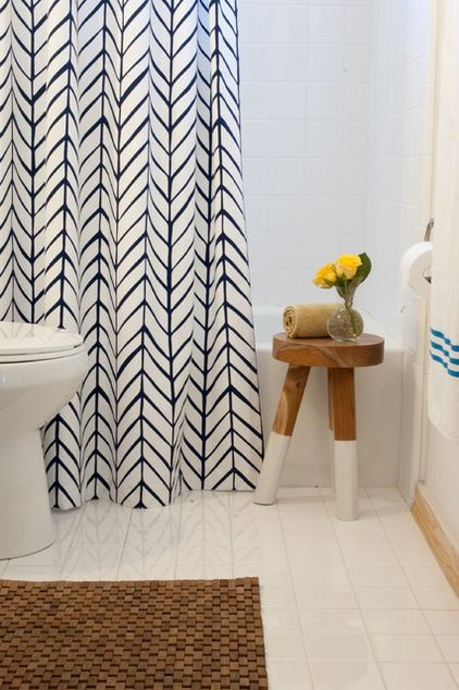 Add a stunning shower curtain and wooden mat to camouflage anything you don't like.