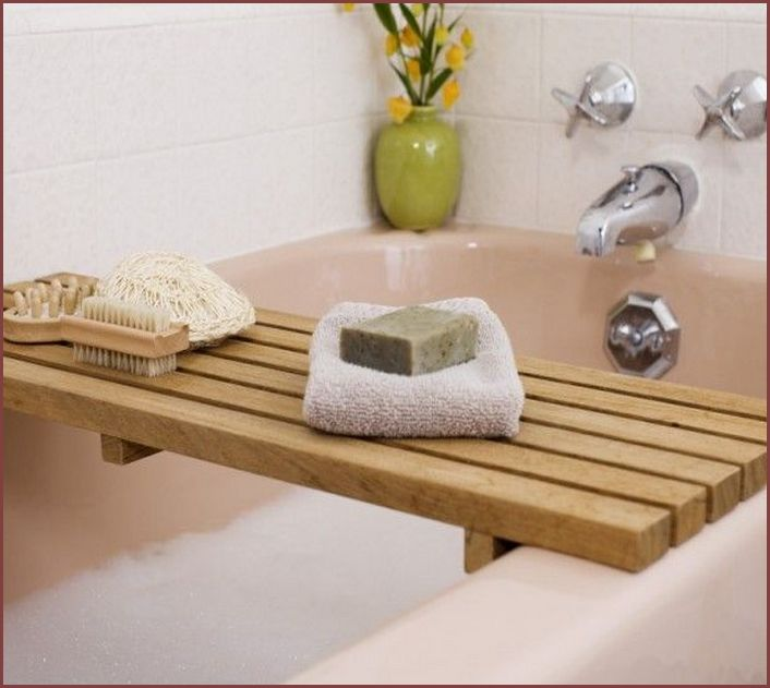 Even if you don't bathe often, a bathtub caddy is a great place to store your shampoos and adds that hit of warmth. Consider cedar wood for a fresh scent every time it gets wet.