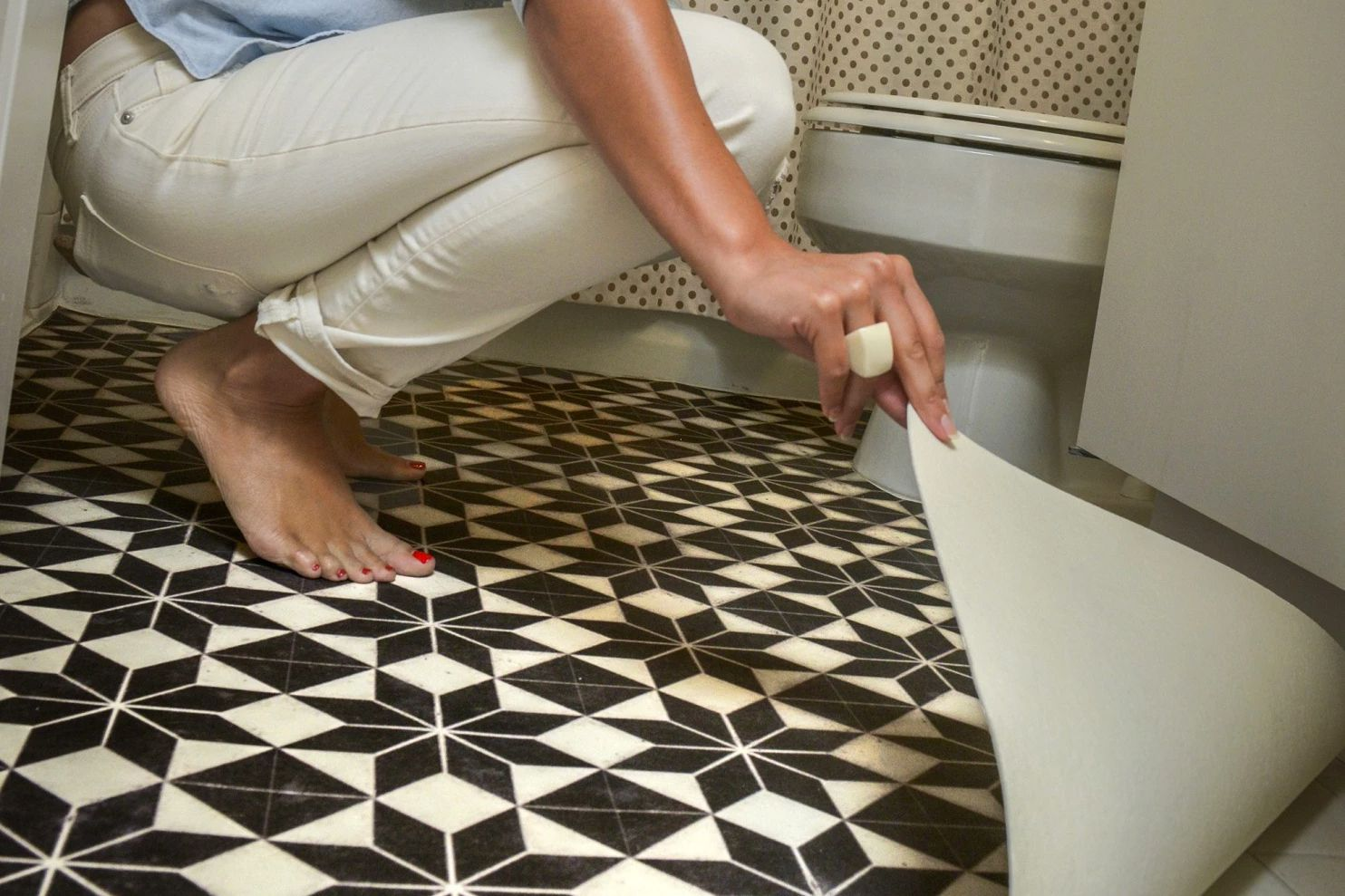 One of my favourite ideas is to cut out vinyl flooring to cover a floor you don't love.