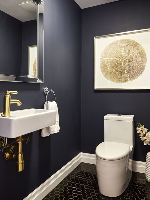 Simply paint the walls in your favourite deep colour and add a gold tap. Instant drama!