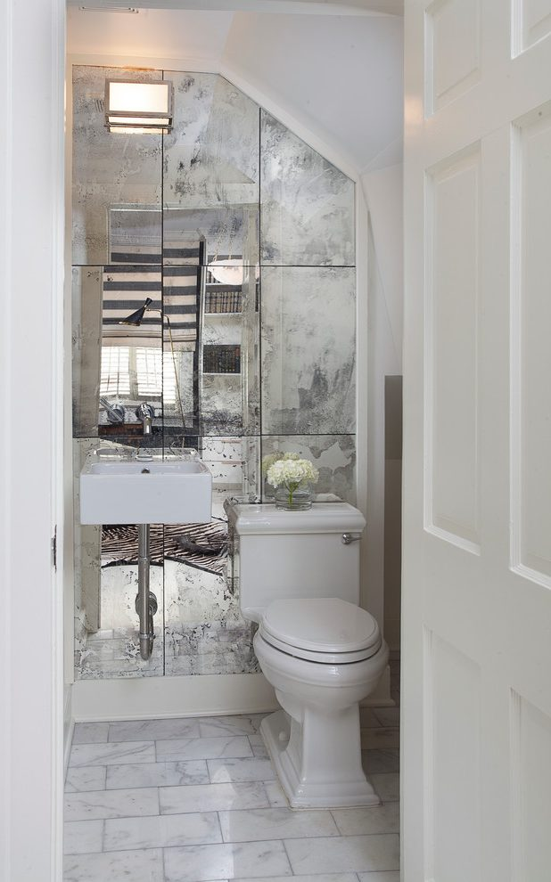 Antique looking mirrors on a full wall really pops in this space!