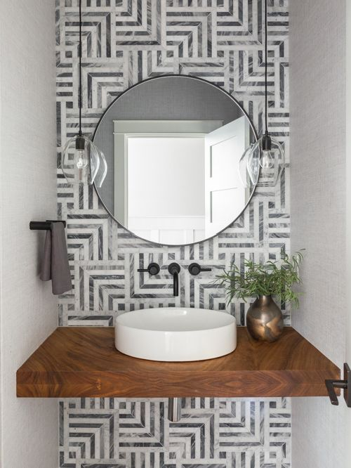 Just one wall behind the sink in your favourite tile, together with some hanging lights, feels right on trend.