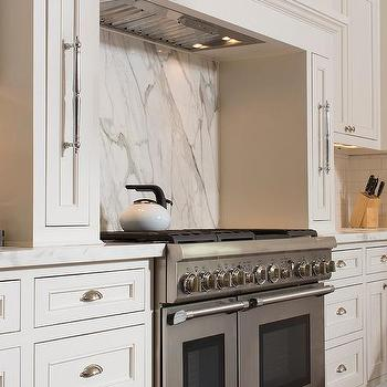 m_concealed-vent-hood-thermador-stove-pull-out-spice-rack-cabinets.jpg