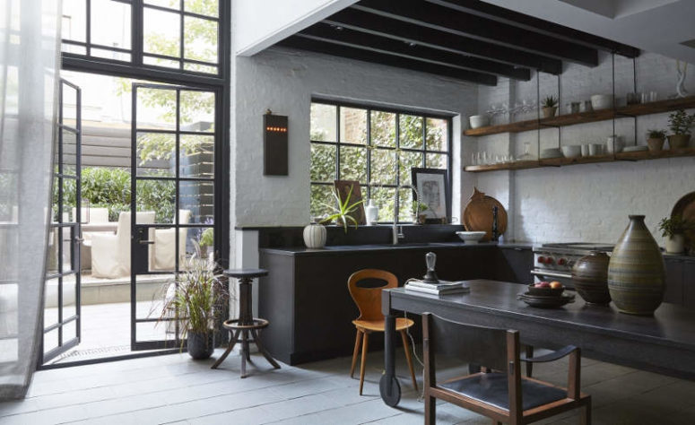 01-This-moody-kitchen-decorted-in-industrial-meets-vintage-style-features-a-classic-black-and-white-color-combo-775x474.jpeg