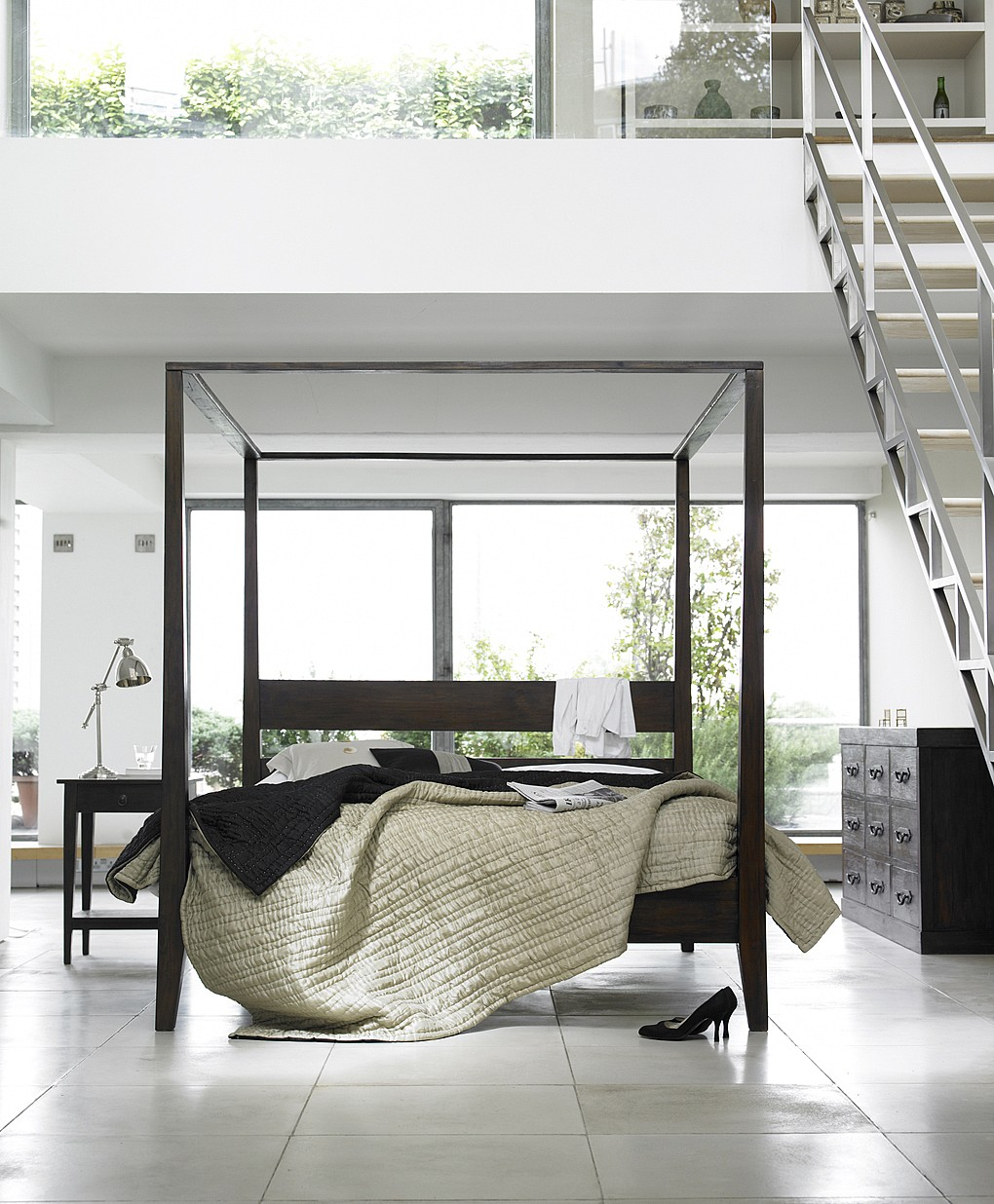 under-stair-living-space-design-with-modest-four-poster-bed-and-home-office-decor.jpg