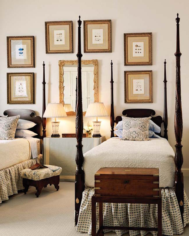 Stunning-four-post-twin-beds-complimented-by-wall-art.jpg