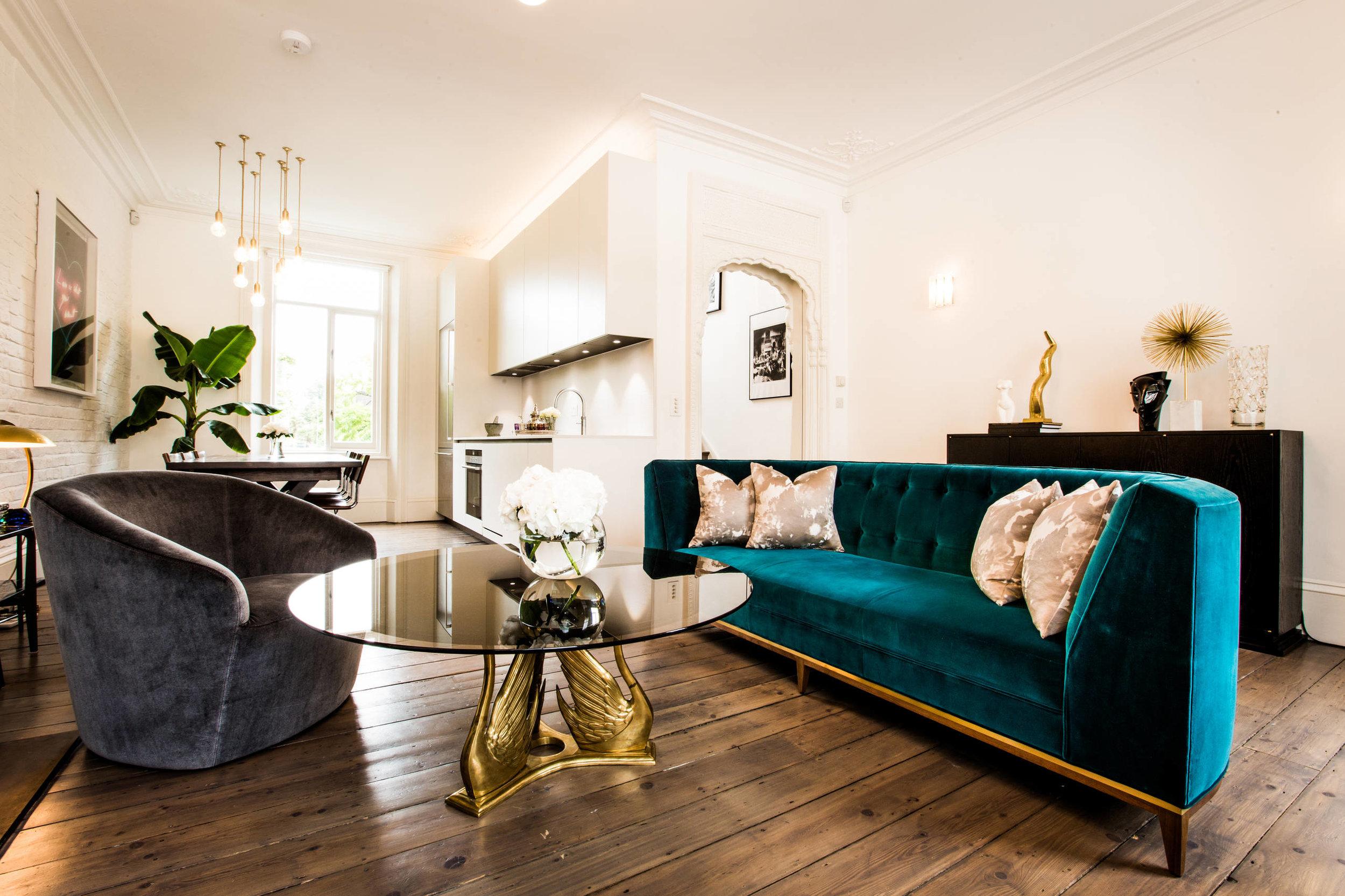 Curvy velvet furniture in deep jewel tones.