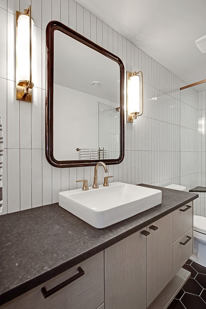 Vertical stacked subway tiles and top mount sinks are very trendy this year.