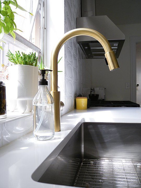 Gold faucets and hardware keeps popping up as the 'it' metal.