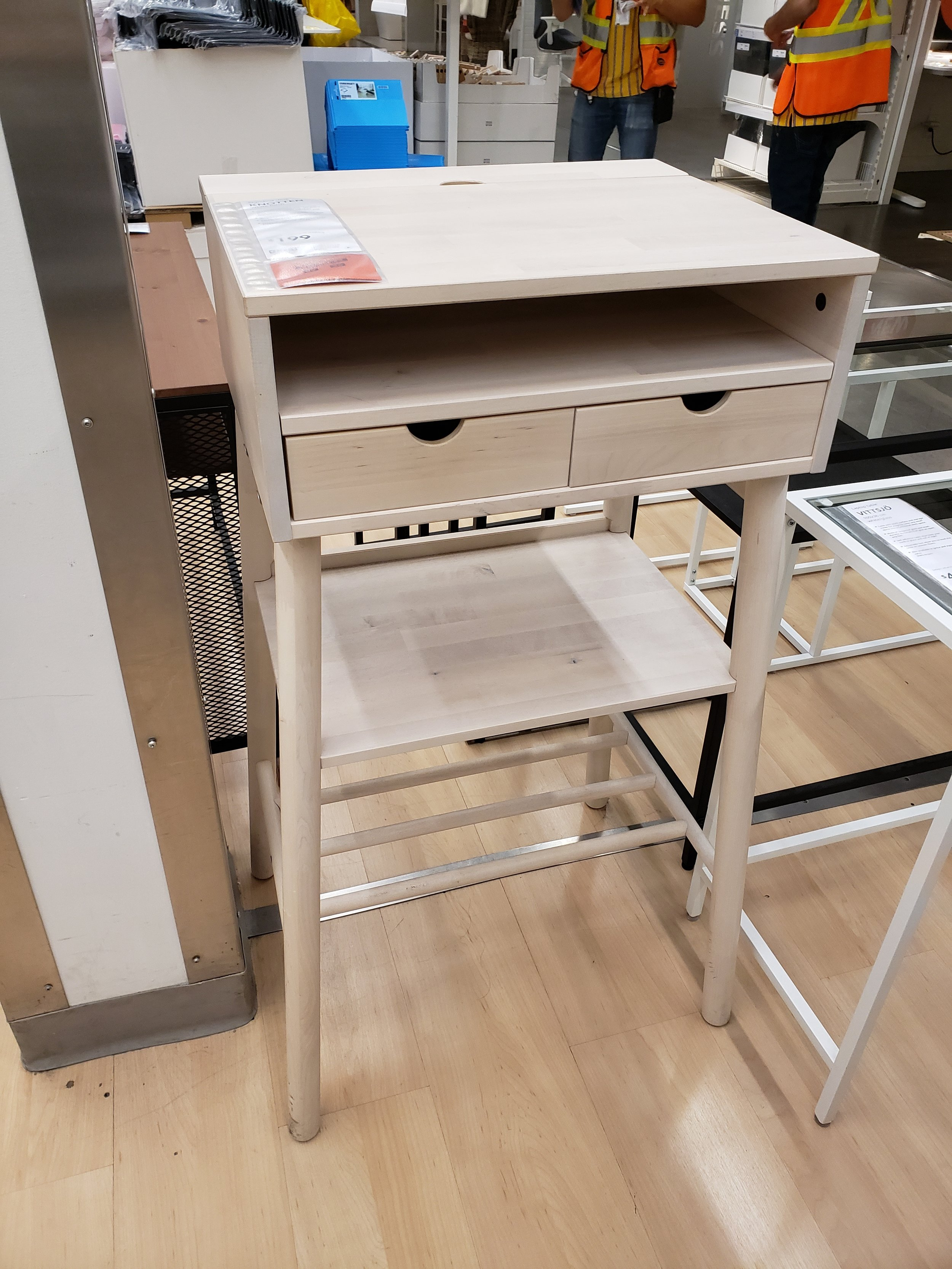 - This standing desk is such a perfect size for a small foyer, or even a corner nook where you want to do a bit of work while standing. The design is incredible with space for wires, odds and ends, and even a spot to put your foot up on. See how versatile it is here.
