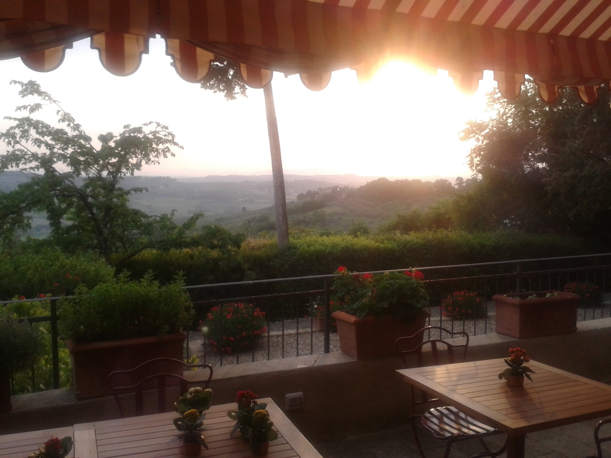 Sunset in the outside dining room of our Tuscan Villa