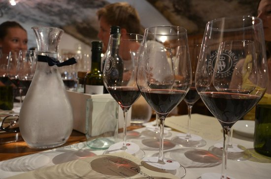 A flight of organic wines await you in the heart of Tuscany.