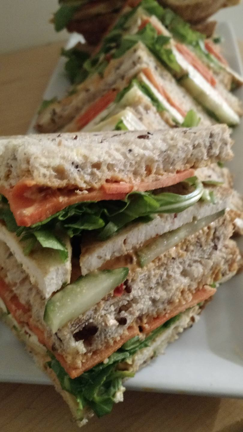 Copy of Copy of Copy of Our vegan tofu sandwich made on our own multigrain bread.