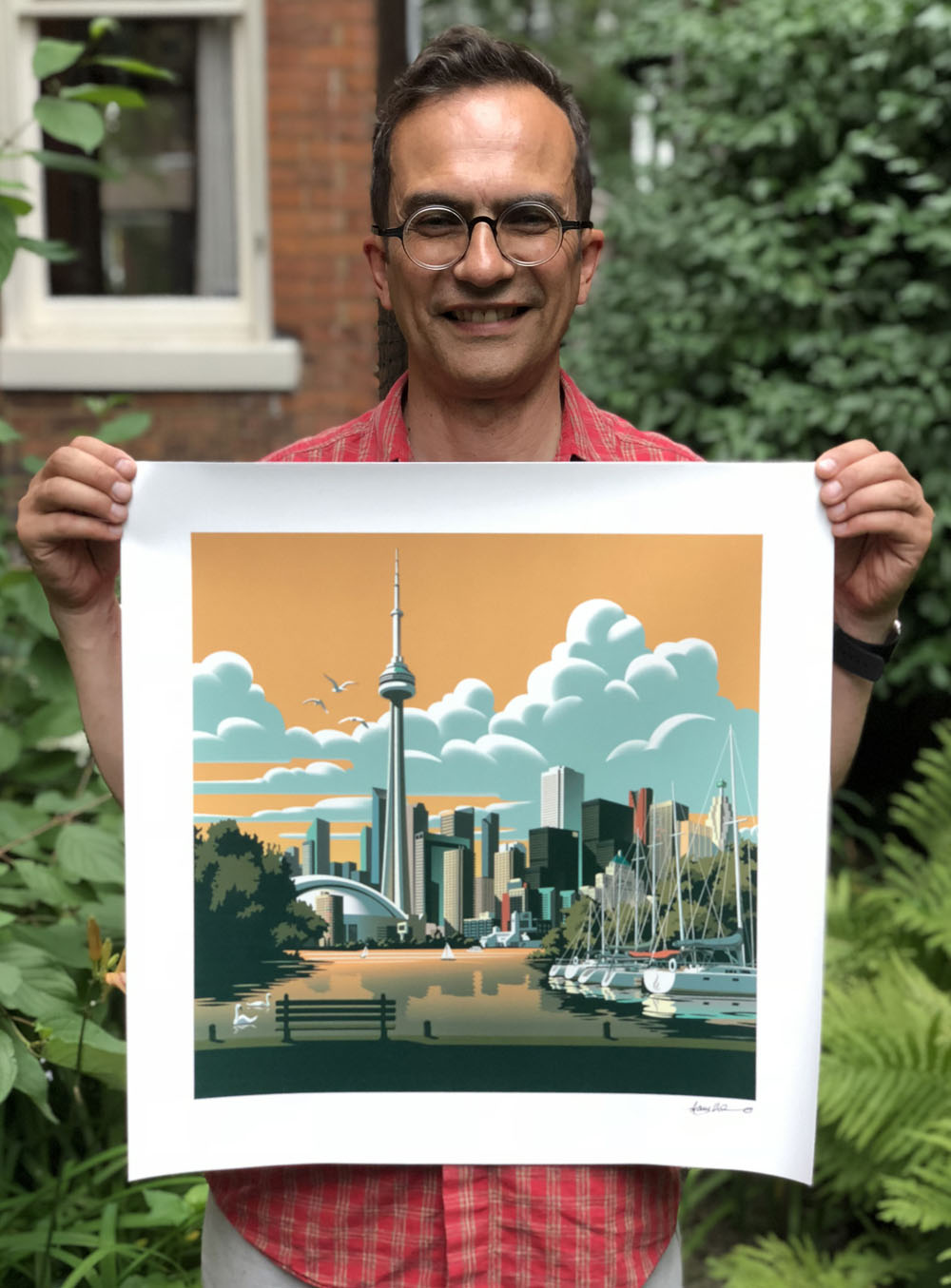 Illustrator Gary Alphonso with a signed print.