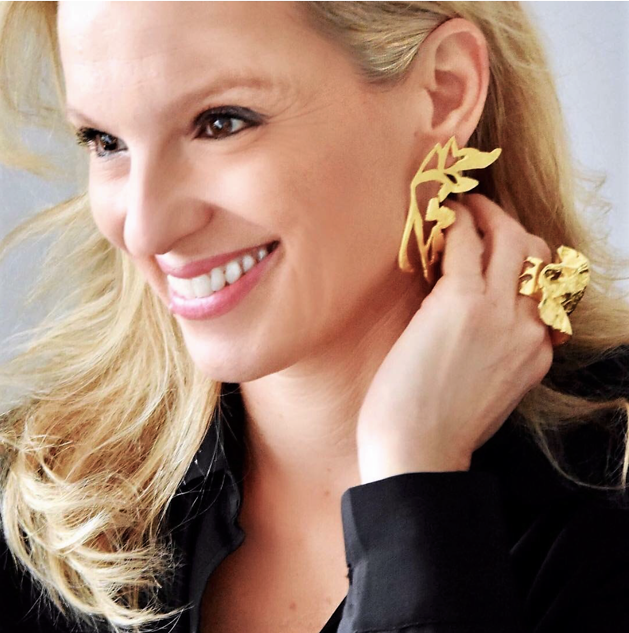 Vanessa Geroulanos with MORPHO earrings & BIG KAHOONA ring.PNG